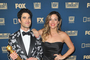 Darren Criss (L), winner of Best Performance by an Actor in a Limited Series or Motion Picture Made for Television, and Mia Swier attend the FOX, FX And Hulu 2019 Golden Globe Awards After Party at The Beverly Hilton Hotel on January 6, 2019 in Beverly Hills, California.