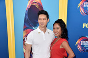Harry Shum Jr. (L) and Shelby Rabara kiss during FOX's Teen Choice Awards at The Forum on August 12, 2018 in Inglewood, California.
