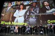 """(L-R) George Lopez, Don Cheadle, Regina Hall, Andrew Rannells, Paul Scheer, Casey Wilson, David Caspe and Jordan Cahan during the panel discussion at the FYC Red Carpet Event For Showtimes' """"Black Monday"""" at Saban Media Center on May 14, 2019 in North Hollywood, California."""
