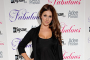 Lucy Pinder arrives at the Fabulous Haircare Range launch party on August 25, 2009 in London, England.