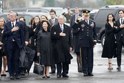(AFP-OUT) Former President George W. Bush, Laura Bush and other family members watch as the flag-draped casket of former President George H.W. Bush is carried by a joint services military honor guard on December 6, 2018 in Houston, Texas. President Bush will be buried at his final resting place at the George H.W. Bush Presidential Library at Texas A&M University in College Station, Texas. A WWII combat veteran, Bush served as a member of Congress from Texas, ambassador to the United Nations, director of the CIA, vice president and 41st president of the United States.