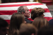 (AFP-OUT) Former President George W. Bush and Laura Bush listen during a funeral service for former President George H.W. Bush at St. Martins Episcopal Church on December 6, 2018 in Houston, Texas. President Bush will be buried at his final resting place at the George H.W. Bush Presidential Library at Texas A&M University in College Station, Texas. A WWII combat veteran, Bush served as a member of Congress from Texas, ambassador to the United Nations, director of the CIA, vice president and 41st president of the United States.