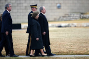 (AFP-OUT) Former President George W. Bush and former first lady Laura Bush follow the casket of former President George H.W. Bush at the George H.W. Bush Presidential Library and Museum Thursday, Dec. 6, 2018, in College Station, Texas.