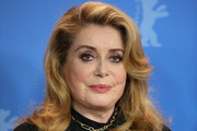 """Catherine Deneuve poses at the """"Farewell To The Night"""" (L'adieu a la nuit) photocall during the 69th Berlinale International Film Festival Berlin at Grand Hyatt Hotel on February 12, 2019 in Berlin, Germany."""