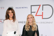 Fashion designer, creative director of Genny, Sara Cavazza Facchini (L) and goodwill ambassador Franca Sozzani attend the Fashion 4 Development's 5th annual Official First Ladies luncheon at The Pierre Hotel on September 28, 2015 in New York City.