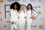 (L-R) Moana Luu, Founder of Fashion 4 Development, Evie Evangelou and Precious Moloi-Motsepe attend Fashion 4 Development's 9th Annual Official First Ladies Luncheon at The Pierre Hotel on September 24, 2019 in New York City.