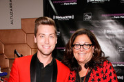 Lance Bass and Fern Mallis attend Fashion's Night Out at Saks Fifth Avenue on September 6, 2012 in New York City.