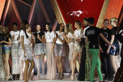(L-R) Valery Kaufman, Maria Borges,Natalia Vodianova,Bella Hadid,Naomi Campbell,Heidi Klum,Natasha Poly and Tami Williams  pose on the runway at the Fashion for Relief event during the 70th annual Cannes Film Festival at Aeroport Cannes Mandelieu on May 21, 2017 in Cannes, France.