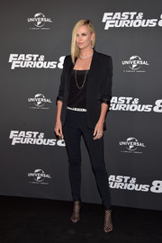 Charlize Theron finished off her fierce look with black cage boots by Christian Louboutin.