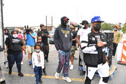 Rapper 2 Chainz and son Halo Epps arrive at 2 Chainz partners with Feed Your City Challenge Team on September 19, 2020 in Atlanta, Georgia. Feed Your City Challenge provided Atlanta's local community members with boxes of fresh groceries, PPE items, and voter registration stations.