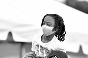 Image has been converted to black and white. The color version is available.)  Rapper 2 Chainz and his son Halo Epps attend the Feed Your City Challenge on September 19, 2020 in Atlanta, Georgia. Feed Your City Challenge provided Atlanta's local community members with boxes of fresh groceries, PPE items, and voter registration stations.