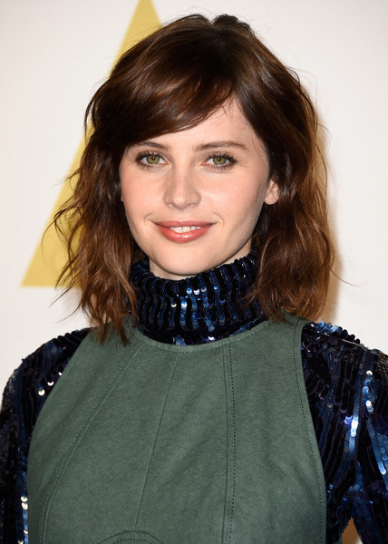 Academy Awards Nominee Luncheon [hair,beauty,human hair color,hairstyle,fashion model,fashion,girl,shoulder,bangs,smile,arrivals,felicity jones,academy awards,beverly hills,california,the beverly hilton hotel,nominee luncheon]