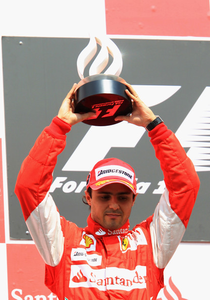 Felipe Massa Second placed Felipe Massa of Brazil and Ferrari celebrates on the podium following the German Grand Prix at Hockenheimring on July 25, 2010 in Hockenheim, Germany.