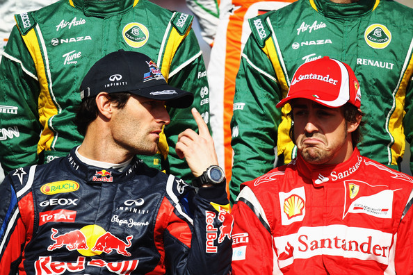 Fernando Alonso Mark Webber (L) of Australia and Red Bull Racing talks with Fernando Alonso (R) of Spain and Ferrari at the drivers official photo before the Australian Formula One Grand Prix at the Albert Park Circuit on March 27, 2011 in Melbourne, Australia.