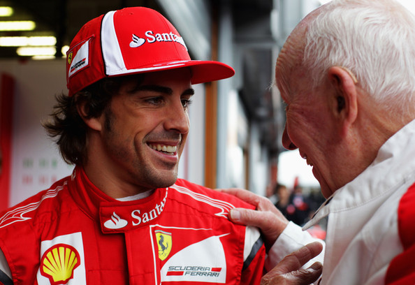 Fernando Alonso Fernando Alonso of Spain and Ferrari talks with former F1 World Champion John Surtees before the final practice session prior to qualifying for the Belgian Formula One Grand Prix at the Circuit of Spa Francorchamps on August 27, 2011 in Spa Francorchamps, Belgium.