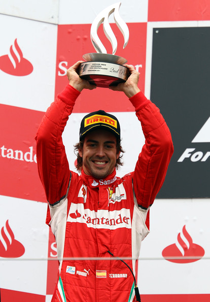 Fernando Alonso Fernando Alonso of Spain and Ferrari celebrates on the podium after finishing second during the German Formula One Grand Prix at the Nurburgring on July 24, 2011 in Nuerburg, Germany.