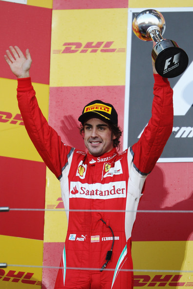 Fernando Alonso Second placed Fernando Alonso of Spain and Ferrari celebrates on the podium following the Japanese Formula One Grand Prix at Suzuka Circuit on October 9, 2011 in Suzuka, Japan.