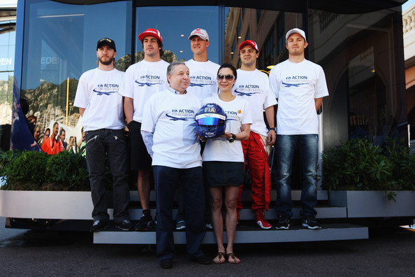 Fernando Alonso F1 drivers Nick Heidfeld, Fernando Alonso, Michael Schumacher, Felipe Massa and Nico Rosberg pose for a photograph with F.I.A. President Jean Todt and his wife Michelle Yeoh to highlight the F.I.A. Road Safety Campaign before qualifying for the Monaco Formula One Grand Prix at the Monte Carlo Circuit on May 28, 2011 in Monte Carlo, Monaco.