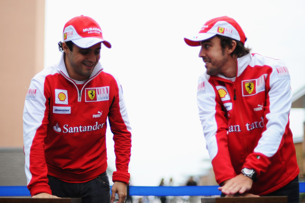Fernando Alonso (L-R) Felipe Massa of Brazil and Ferrari and Fernando Alonso of Spain and Ferrari pose for photographs as they imprint their hands in clay for a permanent exhibition to recognize the first participants of the Korean Formula One Grand Prix at the Korea International Circuit on October 23, 2010 in Yeongam-gun, South Korea.