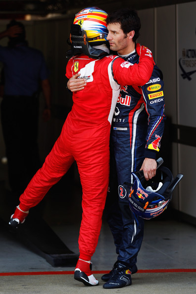 Fernando Alonso Mark Webber (R) of Australia and Red Bull Racing is congratulated by Fernando Alonso (L) of Spain and Ferrari in parc ferme after finishing first during qualifying for the Spanish Formula One Grand Prix at the Circuit de Catalunya on May 21, 2011 in Barcelona, Spain.