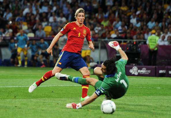 Fernando Torres Fernando Torres of Spain scores his side's third goal past Gianluigi Buffon of Italy during the UEFA EURO 2012 final match between Spain and Italy at the Olympic Stadium on July 1, 2012 in Kiev, Ukraine.
