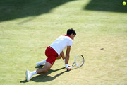 Novak Djokovic of Serbia slips during the match against Grigor Dimitrov of Bulgaria during Day four of the Fever-Tree Championships at Queens Club on June 21, 2018 in London, United Kingdom.