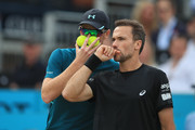 Jamie Murray of Great Britain and Bruno Soares of Brazil (R) discuss tactics during their doubles semi-final match against Oliver Marach of Austria and Mate Pavic of Croatia during day six of the Fever-Tree Championships at Queens Club on June 23, 2018 in London, United Kingdom.