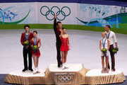 (L-R) Jian Tong and Qing Pang of China win the silver medal, Hongbo Zhao and Xue Shen of China win the gold medal, and Robin Szolkowy and Aliona Savchenko of Germany win the bronze medal in the Figure Skating Pairs Free Program on day 4 of the Vancouver 2010 Winter Olympics at the Pacific Coliseum on February 15, 2010 in Vancouver, Canada.