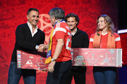 Fabio Cannavaro of Italy greets a Super Fan on the stage as Diego Forlan of Uruguay looks on after the rehearsal for the 2018 FIFA World Cup Draw at the Kremlin on November 30, 2017 in Moscow, Russia.