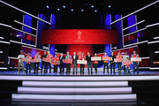 (L-R) Cafu, Laurent Blanc, Nikita Simonyan, Gordon Banks, Fabio Cannavaro and Diego Forlan pose with the Super Fans from the host cities after the rehearsal for the 2018 FIFA World Cup Draw at the Kremlin on November 30, 2017 in Moscow, Russia.