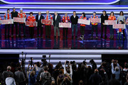 (L-R) Cafu, Laurent Blanc, Nikita Simonyan, Gordon Banks, Fabio Cannavaro, Diego Forlan and Carles Puyol pose with the Super Fans from the host cities after the rehearsal for the 2018 FIFA World Cup Draw at the Kremlin on November 30, 2017 in Moscow, Russia.