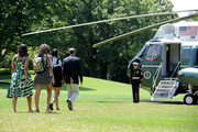 (L-R) U.S. first lady Michelle Obama, daughters Sasha Obama and Malia Obama, and President Barack Obama leave the White House before boarding Marine One on the South Lawn June 17, 2016 in Washington, DC. The first family is traveling to New Mexico and tour Carlsbad Caverns National Park to celebrate the 100th anniversary of the creation of America's national park system.