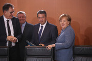 German Chancellor Angela Merkel (R) and other members of her government arrive at the first government cabinet meeting since the collapse of talks over a new government coalition on November 22, 2017 in Berlin, Germany. While the previous German government is still functoning as normal, the creation of a new government following federal elections last September is in limbo after the collapse of coalition talks last Sunday between the Christian Democrats (CDU/CSU), the Free Democrats (FDP) and the Greens Party (Buendnis 90/Die Gruenen). Currently the most likely course is new elections in coming months.