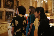 U.S. first lady Melania Trump and Japan's first lady Akie Abe (L) are given a tour of the Flagler museum on April 18, 2018 in Palm Beach, Florida. The first ladies accompanied their husbands U.S. President Donald Trump and Japan's Prime Minister Shinzo Abe to Palm Beach.
