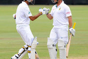 Imran Tahir and Mark Boucher of South Africa celebrate their record partnership during day three of the 1st Test match between South Africa and Sri Lanka at Supersport Park on December 17, 2011 in Pretoria, South Africa.