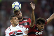 Léo Duarte (C) and Lucas Paqueta of Flamengo struggles for the ball with Diego Souza of Sao Paulo during the match between Flamengo and Sao Paulo as part of Brasileirao Series A 2018 at Maracana Stadium on July 18, 2018 in Rio de Janeiro, Brazil.