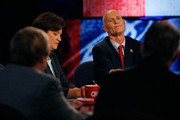 Florida Gubernatorial candidates, Democrat Alex Sink (L) and Republican Rick Scott pause during a debate on October 25, 2010 at the University of South Florida in Tampa, Florida. Sink is currently the Chief Financial Officer for the state of Florida. Scott is the former CEO of the healthcare company Columbia/HCA.