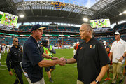 Head coach Butch Davis of the Florida International Golden Panthers and head coach Mark Richt of the Miami Hurricanes shake hands after the game at Hard Rock Stadium on September 22, 2018 in Miami, Florida.