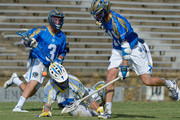 Brendan Fowler #3 and Kevin Drew #19 of the Charlotte Hounds battle Chris Mattes #65 of the Florida Launch for a ground ball during their game at American Legion Memorial Stadium on July 11, 2015 in Charlotte, North Carolina. Florida won 17-16 in overtime.