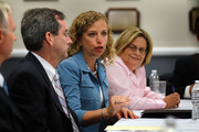 Ed Rappaport, Deputy Director of the National Hurricane Center, Rep. Debbie Wasserman Schultz (D-FL) and  Rep. Ileana Ros-Lehtinen (R-FL) sit together as politicians and officials gathered on the first day of the 2010 Atlantic hurricane season on June 1, 2010 in Opa Locka, Florida. The meeting was conducted to stress the importance of being ready in case a hurricane strikes.