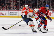 Derek MacKenzie #17 of the Florida Panthers skates the puck against Andrei Markov #79 of the Montreal Canadiens during the NHL game at the Bell Centre on April 5, 2016 in Montreal, Quebec, Canada.