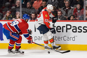 Shawn Thornton #22 of the Florida Panthers tries to play the puck past Andrei Markov #79 of the Montreal Canadiens during the NHL game at the Bell Centre on April 5, 2016 in Montreal, Quebec, Canada.