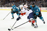 Connor Brickley #23 of the Florida Panthers and Joel Ward #42 of the San Jose Sharks go for the puck at SAP Center on November 16, 2017 in San Jose, California.
