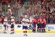 Nicklas Backstrom #19 of the Washington Capitals celebrates with teammates after scoring goal against the Florida Panthers during the third period at Capital One Arena on October 19, 2018 in Washington, DC.