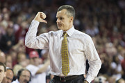 Head Coach Billy Donovan of the Florida Gators signals for a player to go into the game against the Arkansas Razorbacks at Bud Walton Arena on February 5, 2013 in Fayetteville, Arkansas.  The Razorbacks defeated the Gators 80-69.