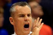 Head coach Billy Donovan of the Florida Gators coaches from the bench during the game against the Kansas Jayhawks at Allen Fieldhouse on December 5, 2014 in Lawrence, Kansas.