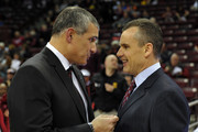 (L-R) Head Coach Frank Martin of the South Carolina Gamecocks talks with Head Coach Billy Donovan of the Florida Gators prior to their game at Colonial Life Arena on March 4, 2014 in Columbia, South Carolina.