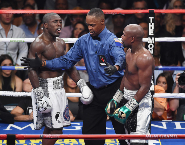 Floyd Mayweather Jr. v Andre Berto [titles,contact sport,professional boxer,sport venue,barechested,boxing,combat sport,boxing glove,professional boxing,boxing ring,striking combat sports,floyd mayweather jr.,kenny bayless,andre berto,c,v,wba,l,round,welterweight title fight]
