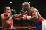 (R-L) Floyd Mayweather Jr. throws a right to the head of Juan Manuel Marquez of Mexico during their welterweight bout at the MGM Grand Garden Arena September 19, 2009 in Las Vegas, Nevada.