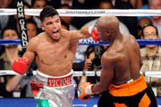 (L-R) Victor Ortiz throws a left to the face of Floyd Mayweather Jr. during their WBC welterweight title fight at the MGM Grand Garden Arena on September 17, 2011 in Las Vegas, Nevada.